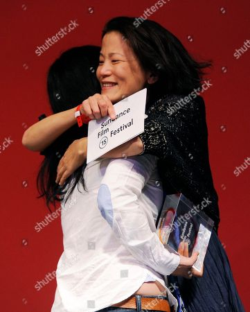 """Jacqueline Kim, right, producer and co-writer of """"Advantageous,"""" hugs co-writer/director Jennifer Phang after the film won the U.S. Dramatic Special Jury Award: Collaborative Vision during the 2015 Sundance Film Festival Awards Ceremony, in Park City, Utah"""