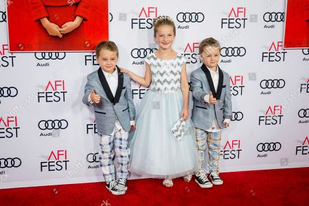 """Stock Image of Sunnie Pelant, center, Aiden Weinberg and Brody Weinberg arrive at the 2016 AFI Festival """"Jackie"""" Centerpiece Gala at the TCL Chinese Theatre, in Los Angeles"""