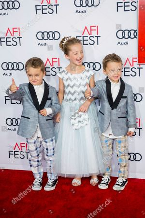 """Sunnie Pelant, center, Aiden Weinberg and Brody Weinberg arrive at the 2016 AFI Festival """"Jackie"""" Centerpiece Gala at the TCL Chinese Theatre, in Los Angeles"""