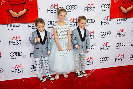 """Stock Picture of Sunnie Pelant, center, Aiden Weinberg and Brody Weinberg arrive at the 2016 AFI Festival """"Jackie"""" Centerpiece Gala at the TCL Chinese Theatre, in Los Angeles"""