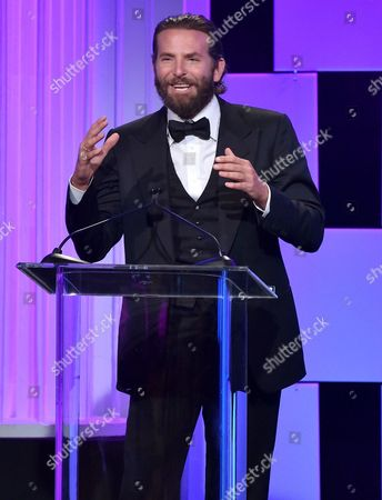 Stock Picture of Bradley Cooper presents the Sid Grauman award at the 30th annual American Cinematheque Award at the Beverly Hilton Hotel, in Beverly Hills, Calif