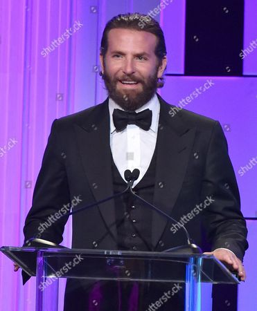 Bradley Cooper presents the Sid Grauman award at the 30th annual American Cinematheque Award at the Beverly Hilton Hotel, in Beverly Hills, Calif