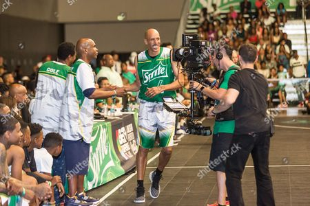Dean Cole, from left, Big Boy, and Doug Christie play at the BET Experience - Sprite celebrity basketball game held at the Los Angeles Convention Center on