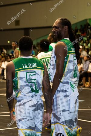 Stock Photo of Lil Durk, left, and Snoop Dogg play at the BET Experience - Sprite celebrity basketball game held at the Los Angeles Convention Center on