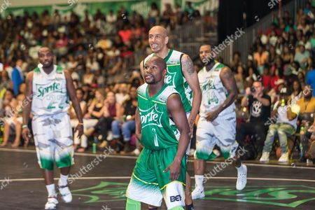 Floyd Mayweather and Doug Christie play at the BET Experience - Sprite celebrity basketball game held at the Los Angeles Convention Center on