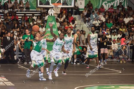 Stock Image of Rotimi, from left, Young Greatness, Lil Durk, Guy Dupuy, and Marcellus Wiley play at the BET Experience - Sprite celebrity basketball game held at the Los Angeles Convention Center on