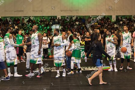 Snoop Dogg, from left, Marcellus Wiley, Young Greatness, Dean Cole, Silento, Lil Durk, and Guy Dupuy play at the BET Experience - Sprite celebrity basketball game held at the Los Angeles Convention Center on
