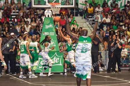 Rotimi, from left, Floyd Mayweather, Snoop Dogg, Kenny Dobbs, and Marcellus Wiley play at the BET Experience - Sprite celebrity basketball game held at the Los Angeles Convention Center on