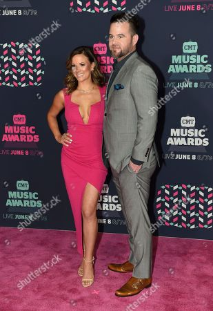 Catherine Werne, left, and David Nail arrive at the CMT Music Awards at the Bridgestone Arena, in Nashville, Tenn