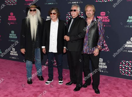 The Oak Ridge Boys, from left, William Lee Golden, Richard Sterban, Joe Bonsall, and Duane Allen arrive at the CMT Music Awards at the Bridgestone Arena, in Nashville, Tenn