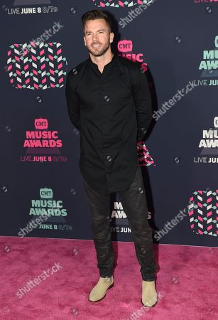 TK McKamy arrives at the CMT Music Awards at the Bridgestone Arena, in Nashville, Tenn