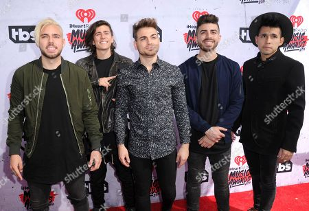 Tomas Slemenson, from left Matt Rey, Juan Pablo Casilla, Hector Rodriguez and Ismael Cano of the band 'LOS 5' arrive at the iHeartRadio Music Awards at The Forum, in Inglewood, Calif