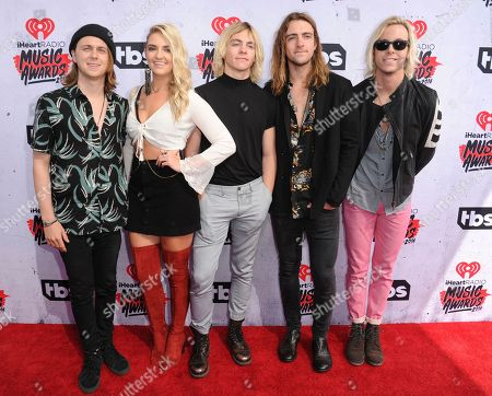 Ellington Ratliff, from left Rydel Lynch, Ross Lynch, Rocky Lynch, Riker Lynch of R5 arrive at the iHeartRadio Music Awards at The Forum, in Inglewood, Calif