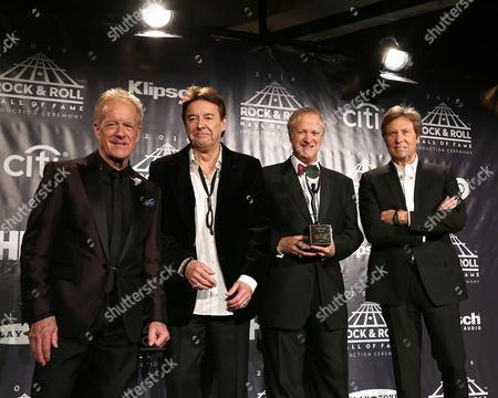 James Pankow, from left, Walter Parazaider, Lee Loughnane and Robert Lamm of the group Chicago pose in the press room at the 31st Annual Rock and Roll Hall of Fame Induction Ceremony at the Barclays Center, in New York