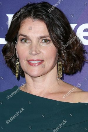 "Julia Ormond, a cast member in the television series ""Incorporated,"" arrives at the NBCUniversal Television Critics Association summer press tour, in Beverly Hills, Calif"