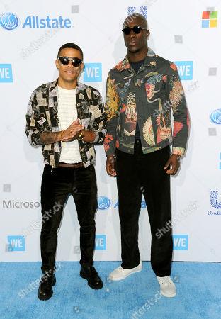 Stock Picture of Nico Sereba, left, and Vinz Dery arrive at WE Day California at the Forum, in Inglewood, Calif