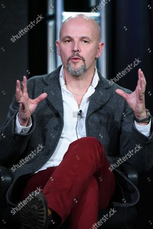 """Peter Carlton appears on stage during the """"The Last Panthers"""" panel at the AMC 2016 Winter TCA, in Pasadena, Calif"""
