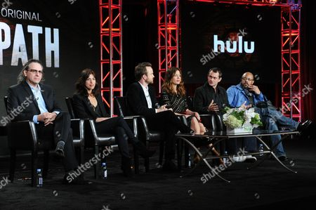 """Executive producer Jason Katims, from left, executive producer and creator Jessica Goldberg, actors Aaron Paul, Michelle Monaghan, Hugh Dancy and Rockmond Dunbar participate in """"The Path"""" panel at the Hulu 2016 Winter TCA, in Pasadena, Calif"""