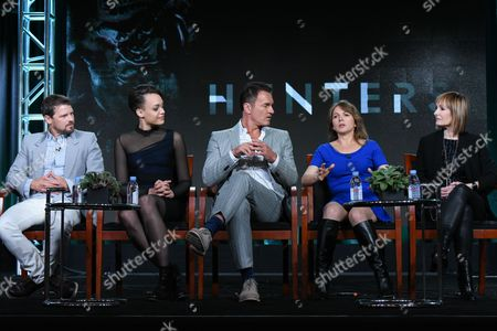 """Stock Image of Actors Nathan Phillips, from left, Britne Oldford, Julian McMahon, executive producers Natalie Chaidez and Gale Anne Hurd participate in Syfy's """"Hunters"""" panel at the NBCUniversal Winter TCA, Pasadena, Calif"""