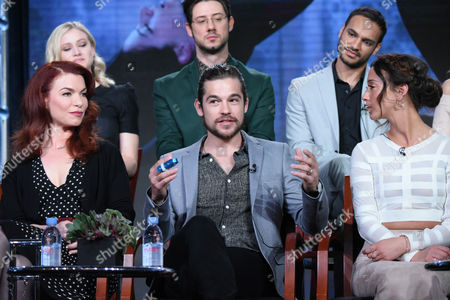 """Olivia Taylor Dudley, top from left, Hale Appleman, and Arjun Gupta, front from left, executive producer Sera Gamble, Jason Ralph and Stella Maeve participate in Syfy's """"The Magicians"""" panel at the NBCUniversal Winter TCA, Pasadena, Calif"""