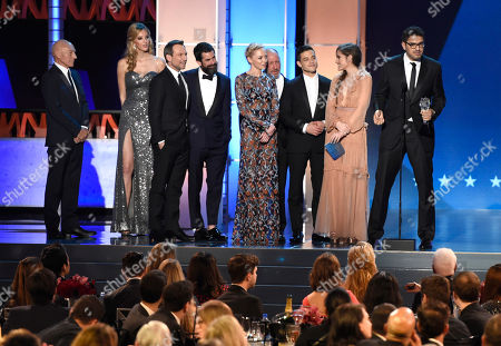 "Stock Picture of Sir Patrick Stewart, left, looks on as Christian Slater, from third left, Chad Hamilton, Portia Doubleday, Steve Golin, Rami Malik, Carly Chaikin, and Sam Esmail accept the award for best drama series for ""Mr. Robot"" at the 21st annual Critics' Choice Awards at the Barker Hangar, in Santa Monica, Calif"