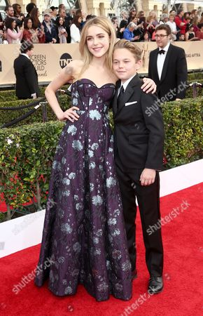 Kiernan Shipka, left, and Mason Vale Cotton arrive at the 22nd annual Screen Actors Guild Awards at the Shrine Auditorium & Expo Hall, in Los Angeles
