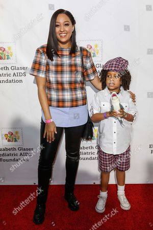 "Tia Mowry, left, and her son Cree Taylor Hardrict arrive at the 27th Annual ""A Time for Heroes"" Family Festival, in Culver City, Calif"