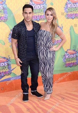 Alexa Vega, right, and Carlos Pena, Jr. arrive at the 27th annual Kids' Choice Awards at the Galen Center, in Los Angeles