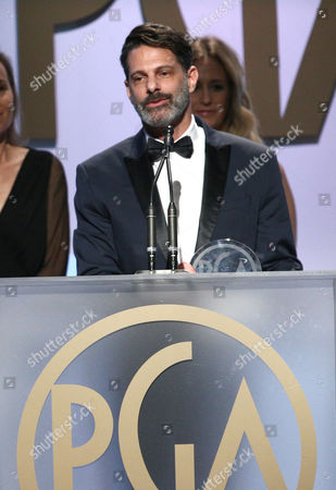 Lee Metzger accepts the award for outstanding producer of competition television for The Voice at the 27th annual Producers Guild Awards at the Hyatt Regency Century Plaza, in Los Angeles