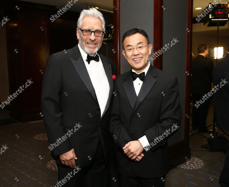 Hawk Koch, left, and Dr. Jack Gao attend the 27th annual Producers Guild Awards at the Hyatt Regency Century Plaza, in Los Angeles