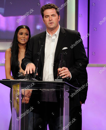 Stock Photo of Elwood Reid accepts the award for best primetime television program: drama or comedy for The Bridge at the 29th annual Imagen Awards at the Beverly Hilton Hotel, in Beverly Hills, Calif