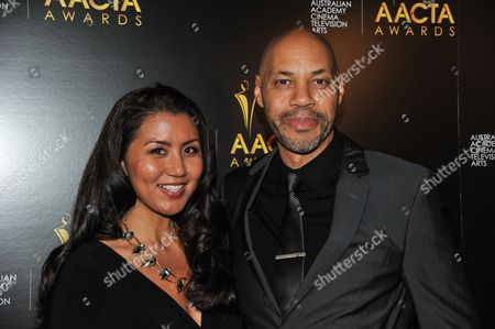 Gayle Yoshida, left, and John Ridley arrive at the 3rd Annual AACTA International Awards, on Friday, January,10, 2014 in West Hollywood, Calif
