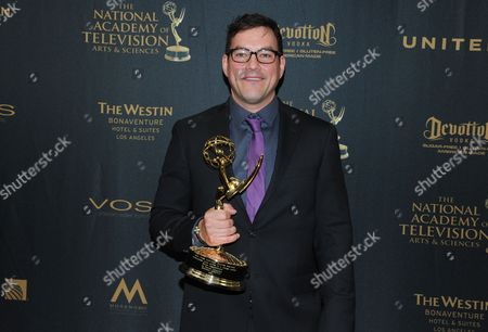 Tyler Christopher poses in the pressroom with the award for outstanding lead actor for General Hospital at the 43rd annual Daytime Emmy Awards at the Westin Bonaventure Hotel, in Los Angeles