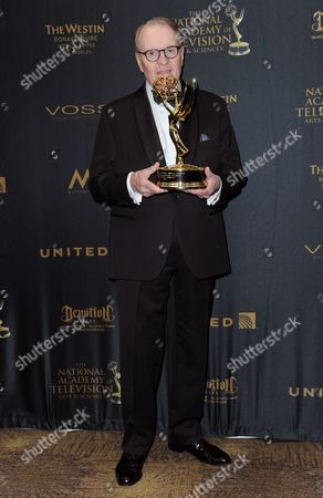 Stock Image of Charles Osgood poses in the pressroom with the award for outstanding morning program for CBS Sunday Morning at the 43rd annual Daytime Emmy Awards at the Westin Bonaventure Hotel, in Los Angeles