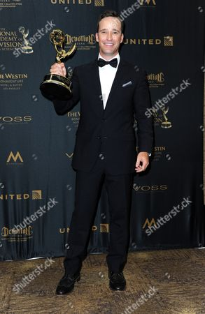 Mike Richards poses in the press room with the award for outstanding game show for The Price is Right at the 43rd annual Daytime Emmy Awards at the Westin Bonaventure Hotel, in Los Angeles