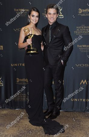 Stock Image of True O'Brien, winner of the award for outstanding younger actress for Days of Our Lives, left, and Casey Moss pose in the pressroom at the 43rd annual Daytime Emmy Awards at the Westin Bonaventure Hotel, in Los Angeles