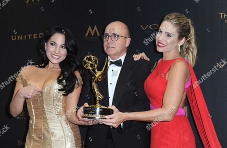 Alejandra Oraa, from left, Eduardo Suarez, and Maria Alejandra Requena pose in the pressroom with the award for outstanding morning show in Spanish for Cafe CNN at the 43rd annual Daytime Emmy Awards at the Westin Bonaventure Hotel, in Los Angeles