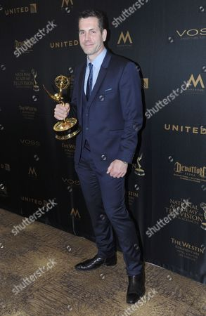 Frank Valentini poses in the pressroom with the award for outstanding drama series for General Hospital at the 43rd annual Daytime Emmy Awards at the Westin Bonaventure Hotel, in Los Angeles
