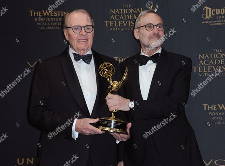 "Charles Osgood, left, and Rand Morrison pose in the pressroom with the award for outstanding morning program for ""CBS Sunday Morning"" at the 43rd annual Daytime Emmy Awards at the Westin Bonaventure Hotel, in Los Angeles"