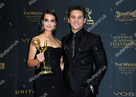 Stock Picture of True O'Brien, winner of the award for outstanding younger actress for Days of Our Lives, left, and Casey Moss pose in the press room at the 43rd annual Daytime Emmy Awards at the Westin Bonaventure Hotel, in Los Angeles