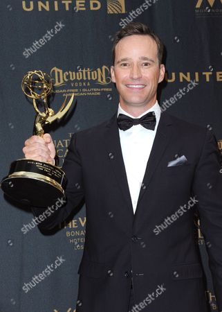 Mike Richards poses in the pressroom with the award for outstanding game show for The Price is Right at the 43rd annual Daytime Emmy Awards at the Westin Bonaventure Hotel, in Los Angeles