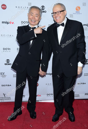 George Takei, left, and Brad Altman attend the 43rd International Emmy Awards at the New York Hilton Hotel, in New York