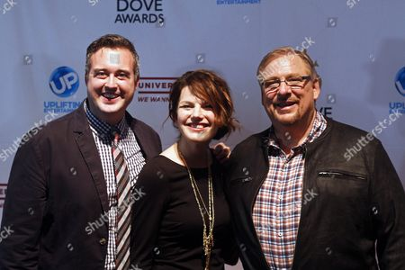 Rick Warren, right, arrives with John Cassetto and Stephanie Cassetto at the 44th Annual GMA Dove Awards at the Lipscomb University's Allen Arena on in Nashville, Tenn