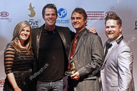 Amanda Crabb, Aaron Brabb, Tim Duncan, and Michael Sykes of Canton Junction arrive at the 44th Annual GMA Dove Awards at the Lipscomb University's Allen Arena on in Nashville, Tenn