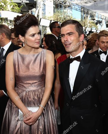 Betsy Brandt and Hugh Acheson arrive at the 65th Primetime Emmy Awards at Nokia Theatre, in Los Angeles