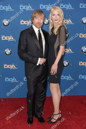 Director Morten Tyldum, left, and Janne Tyldum arrive the 67th Annual DGA Awards, in Los Angeles