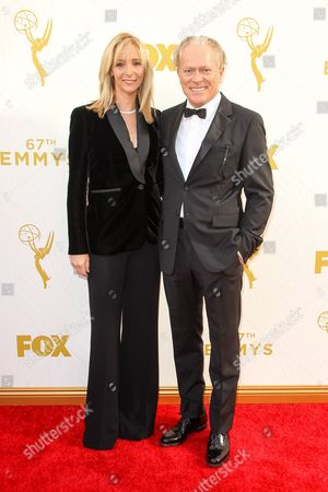 Stock Image of Lisa Kudrow, left, and Michel Stern arrive at the 67th Primetime Emmy Awards, at the Microsoft Theater in Los Angeles