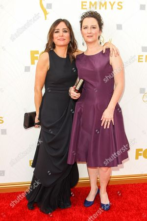 Pamela Adlon, left, and M. Blair Breard arrive at the 67th Primetime Emmy Awards, at the Microsoft Theater in Los Angeles