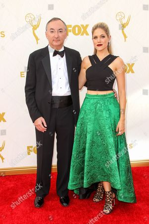 Peter Kosminsky, left, and Charity Wakefield arrive at the 67th Primetime Emmy Awards, at the Microsoft Theater in Los Angeles