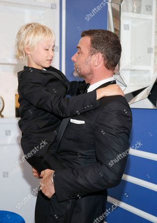 Liev Schreiber, right, and Alexander Pete Schreiber pose backstage at the 68th Primetime Emmy Awards in the Chase Sapphire Reserve Blue Room, at the Microsoft Theater in Los Angeles